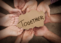 Together-Written-on-Cardboard-Being-Held-by-Group-of-People-000042752202_Small_200x140px